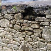 Cemetery wall undergoing repair
